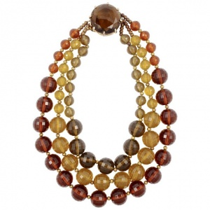 Gold Plated Triple Strand Plastic Bead Necklace with a Glass Clasp