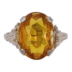 Art Deco Silver Tone Ring with an Oval Gold Glass Stone