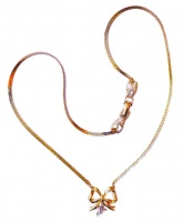 Nina Ricci Gold Tone Necklace with Bow Pendant